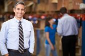 stock photo of warehouse  - Portrait Of Manager In Warehouse - JPG