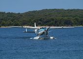 stock photo of cessna  - sea plane landing on water surface  - JPG