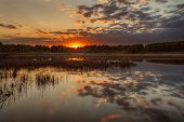 pic of novosibirsk  - Beautiful sunset above the Bykovo lake in Novosibirsk region  - JPG