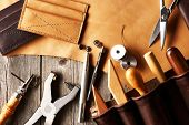 stock photo of leather tool  - Leather crafting tools still life - JPG