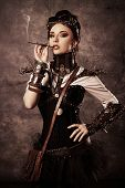 foto of post-apocalypse  - Portrait of a beautiful steampunk woman over grunge background - JPG
