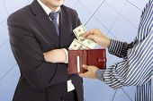 stock photo of douceur  - Giving a bribe - JPG