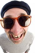 picture of honkers  - middle age senior man happy smiling wearing artist french hippie beret hat macro close up distorted large nose face - JPG