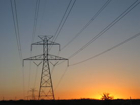 picture of power lines  - electricty power lines during a sunset in Texas