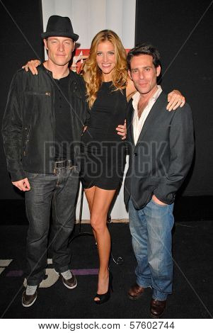 Tahmoh Penikett, Tricia Helfer and James Callis at the Maxim Cover party featuring Tricia Helfer and Grace Park, MI6, West Hollywood, CA.  10-20-09