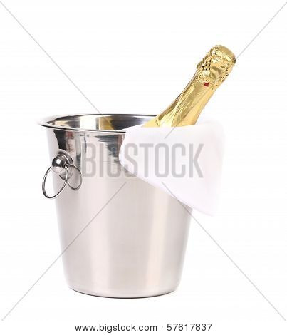 Bottle of champagne in cooler.