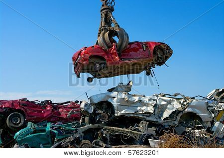Crane Picking Up Car