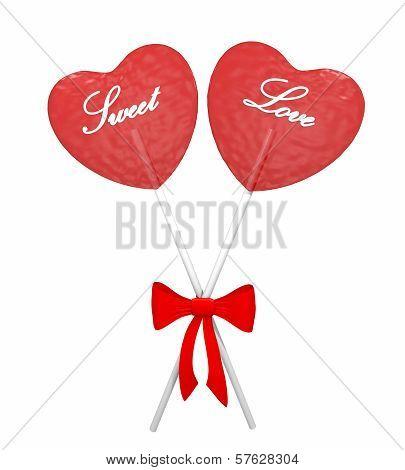 Two red heart lollipops