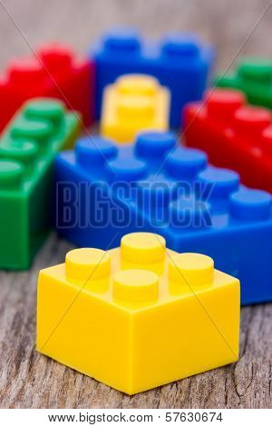 Color Plastic  Blocks On Wooden Background