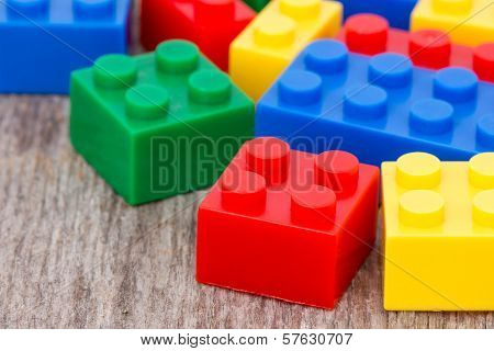 Plastic  Blocks On The Wooden Background