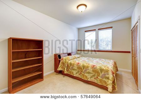 Warm Simple Bedroom With Wooden Furniture