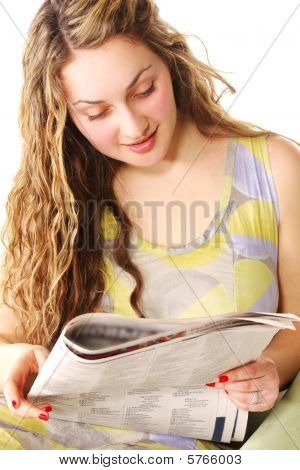 Curly Woman Reading Newspaper