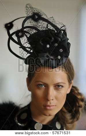 Young model wearing designers hat