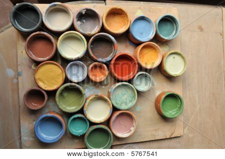 array of paints of differnet colors in a ceramics studio