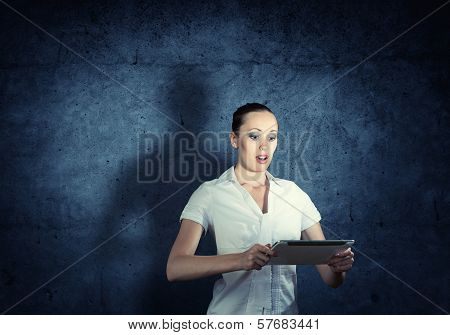 young attractive woman holding a tablet