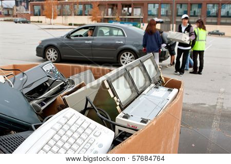 People Drop Off Electronics At Recycling Event