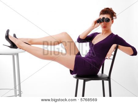 Youth Woman Sitting On Chair And Looking On Binoculars.