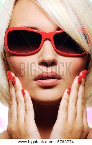 Female Face In Fashion Red Sunglasses