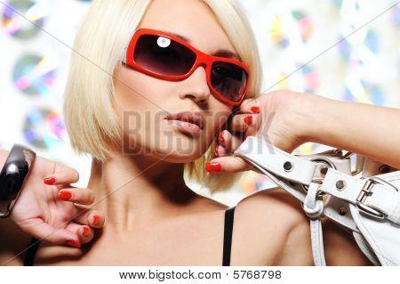 Woman In Bright Red Sunglasses