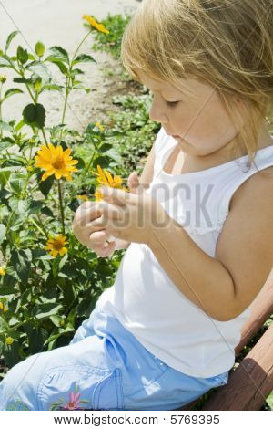 Girl Holds Flower