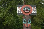 image of totem pole  - Wooden totem pole in Vancouver garden in Canada - JPG