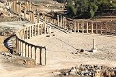 stock photo of cardo  - The oval forum at the roman ruins of Jerah - JPG