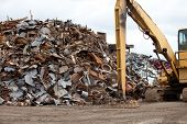 stock photo of junk-yard  - Scrap metal piles in a recycling center - JPG