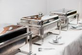 foto of chafing  - Chafing Dish made of stainless steel at buffet - JPG