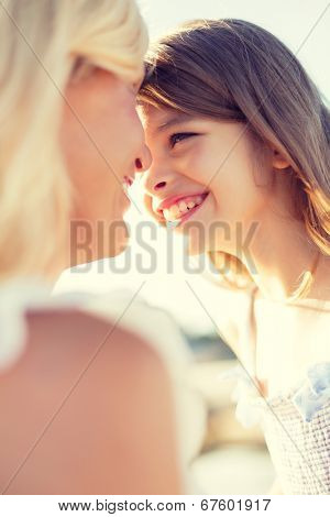summer holidays, family, children and people concept - happy mother and child girl outdoors