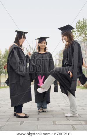 Three Female Graduates Playing Game
