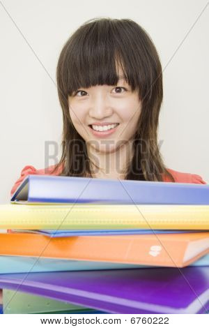 Young Woman Holding Colorful Notebooks