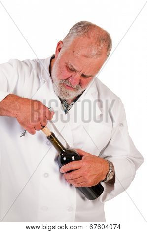 Sommelier removing a cork from a bottle of red wine
