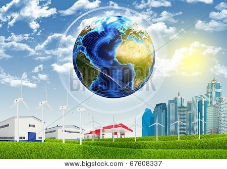 Earth, grass, skyscrapers and industrial area