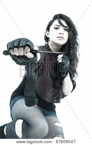 punk young girl with knife on her hand
