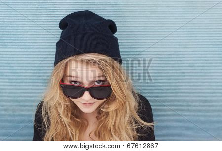 Cool Teenager Wtih Wool Hat And Sunglasses