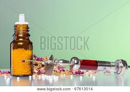 Still Life With Homeopathy Globule, Syringe With Blood And Some Spices