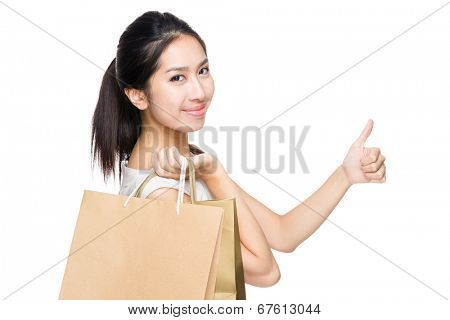 Asian woman with shopping bag and thumb up