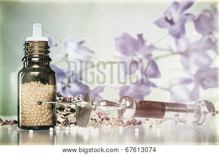 Vintage Still Life With Homeopathy Globule, Syringe With Blood, Some Spices And Flowers