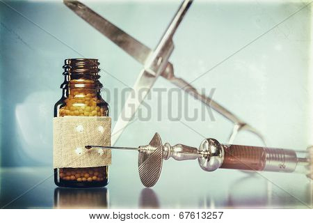 Vintage Still Life With Homeopathy Globules. Syringe With Blood,  Plaster And Scissors