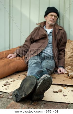 Homeless Man With Holes In His Shoes