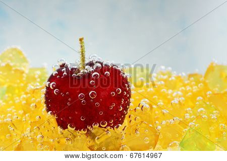 cherry with bubbles on a blue background