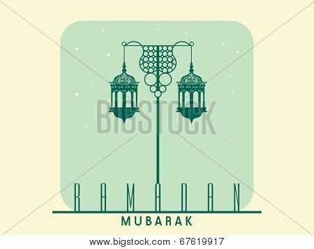 Beautiful street light lamps on vintage beige and green background for the celebrations of holy month of Muslim community Ramadan Mubarak.