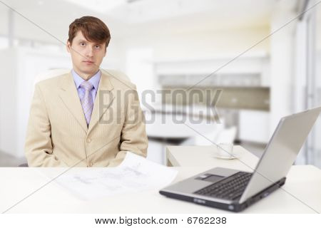 Young Serious Businessman On A Workplace