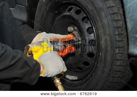 Tyre Fitting With Air Compressed Wrench