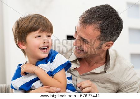 Happy Father And Son Playing With Each Other