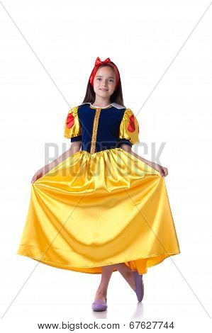Charming girl dressed as Snow White doing curtsy