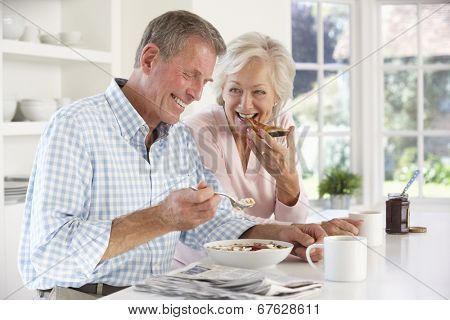 Retired couple eating breakfast