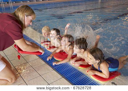Children having swimming lesson