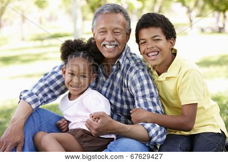 Grandfather and grandchildren in park