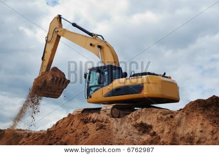 Excavator With Earth In The Bucket